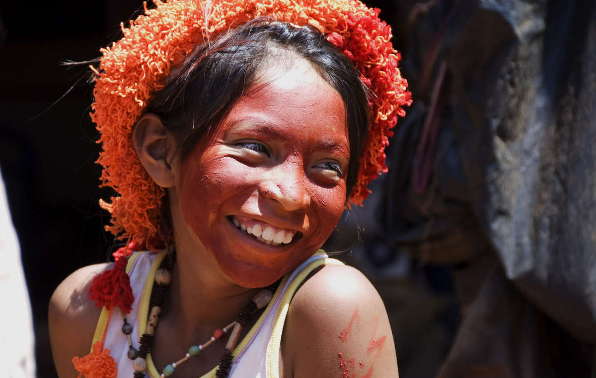 The Guarani use urucum dye of the annatto shrub to paint their faces and bodies during festivities, Brazil.