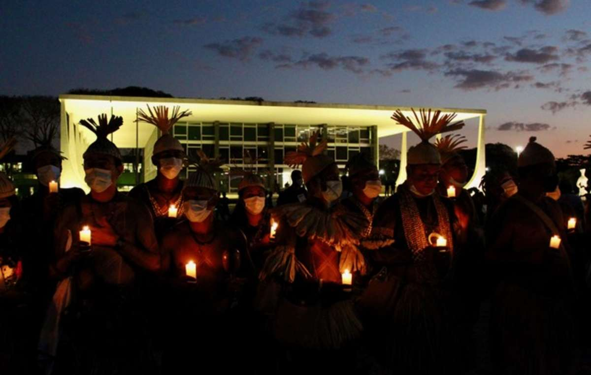 Indigenous protestors hold a vigil in Brasilia on the night before the Supreme Court begins its vote on the Time Limit Trick. 2021