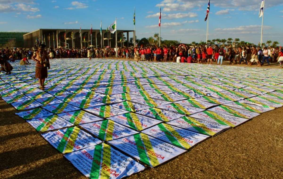 Indigenous people lay out the names of indigenous territories that will be affected if the Time Limit Trick were to be passed by the Supreme Court, Brasilia, 2021.