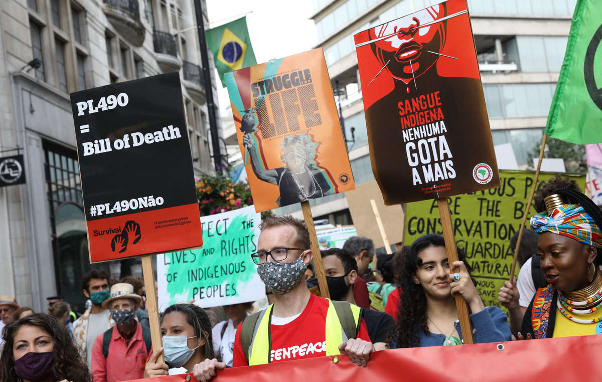 Protesters in London stand in solidarity with Brazil's Indigenous Peoples outside the Brazilian Embassy in London.