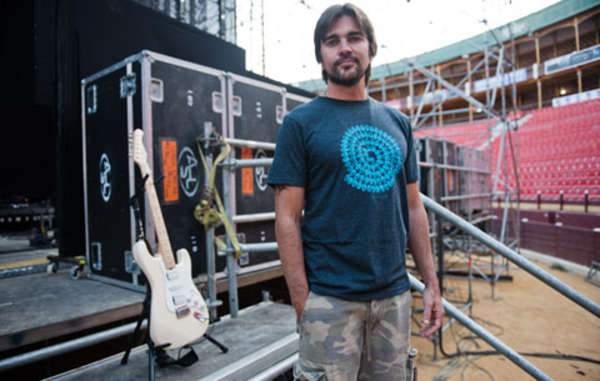 Juanes models the t-shirt designed by artist Richard Long for Survival.
