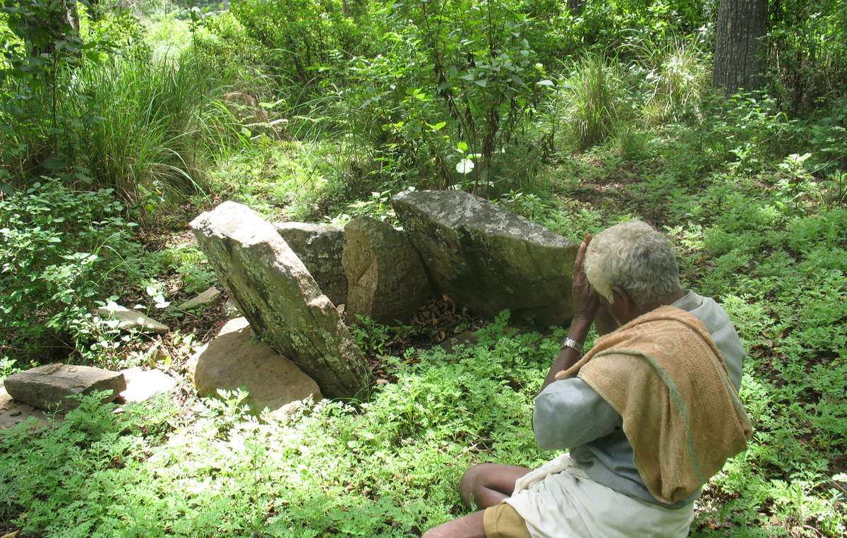 A Soliga man worships at a sacred site inside his land, which is now a tiger reserve.
