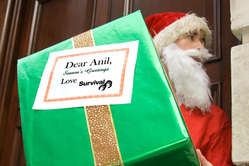 Santa delivers a Christmas present to Vedanta chief Anil Agarwal: a copy of Survival's complaint to the OECD