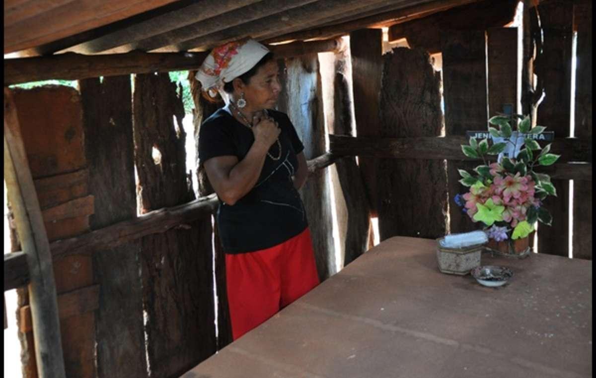 Genivaldo Veras mother next to his tomb. He was killed by gunmen in 2009.