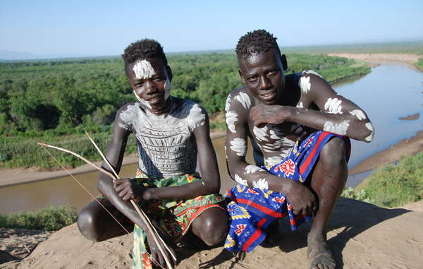 Two Karo boys in front of a full Omo River. Water levels are now unrecognizably low.