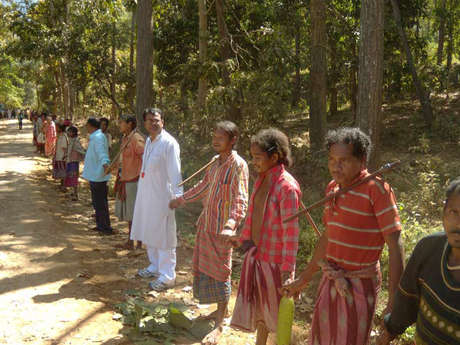 The Dongria Kondh form a human chain to express their opposition to Vedanta's mine.
