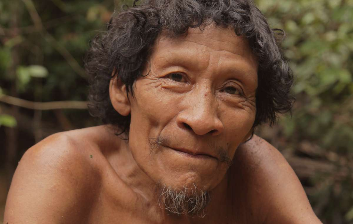 Karapiru Awá saw his entire family massacred by karai (non-indigenous people). He escaped and lived on his own for 10 years. Eventually he was reunited with his son, who had survived the attack. ©F Watson/Survival