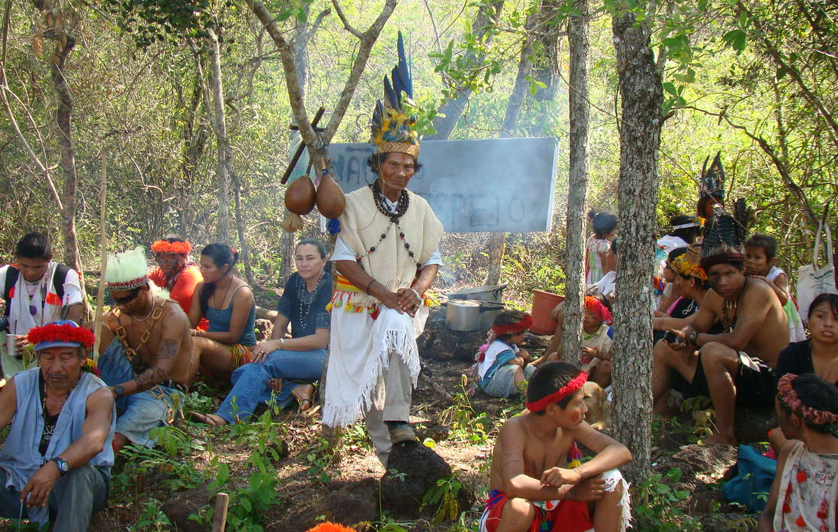 Guarani from Leia's community gather for a protest ritual on their ancestral land.