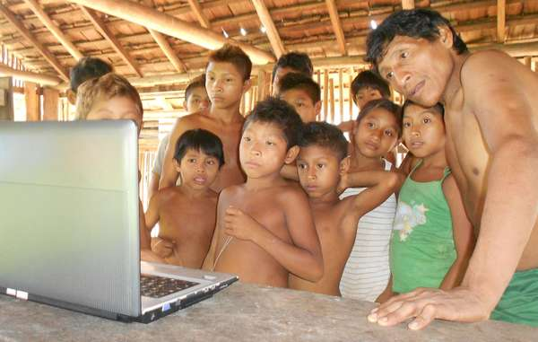 Awá watching Survival's film. The tribe want Brazil's Justice Minister to actfast.