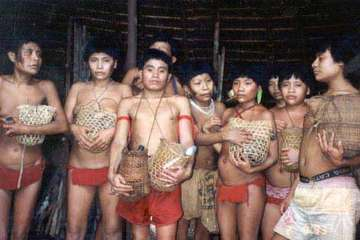 Survivors of the Haximu massacre in which gold-miners killed 16 Yanomami Indians, hold urns containing the ashes of their relatives.