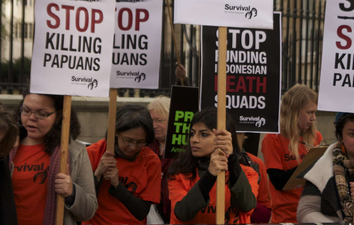 Dozens of protesters gathered outside Downing Street to mark the visit of Indonesia's President.