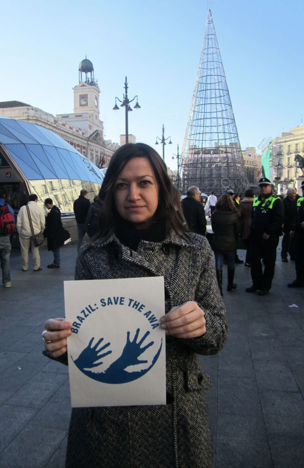 A woman showing her support for the 'Brazil: Save the Awá' campaign, Puerta del Sol square, Madrid, Spain.