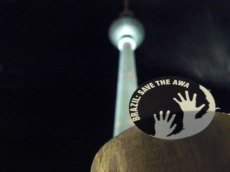 A Survival sticker in front of the Berliner Fernsehturm, Berlin.