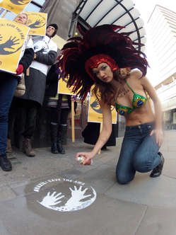 """""""A London supporter in carnival costume carried a message for Brazil to 'Save the Awá'."""""""