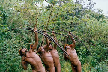 Awá men hunting in the forest, Brazil.