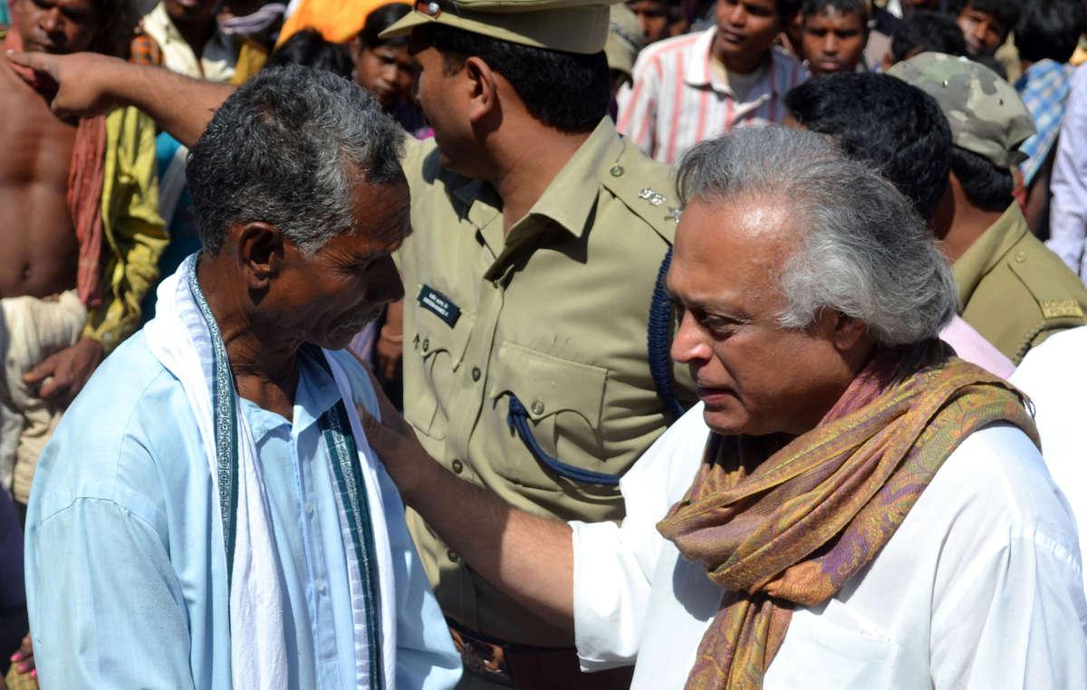Minister Ramesh listens to the concerns of Kumti Majhi, Kondh leader