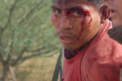 One of many Indians wounded in the Bagua protest is arrested.