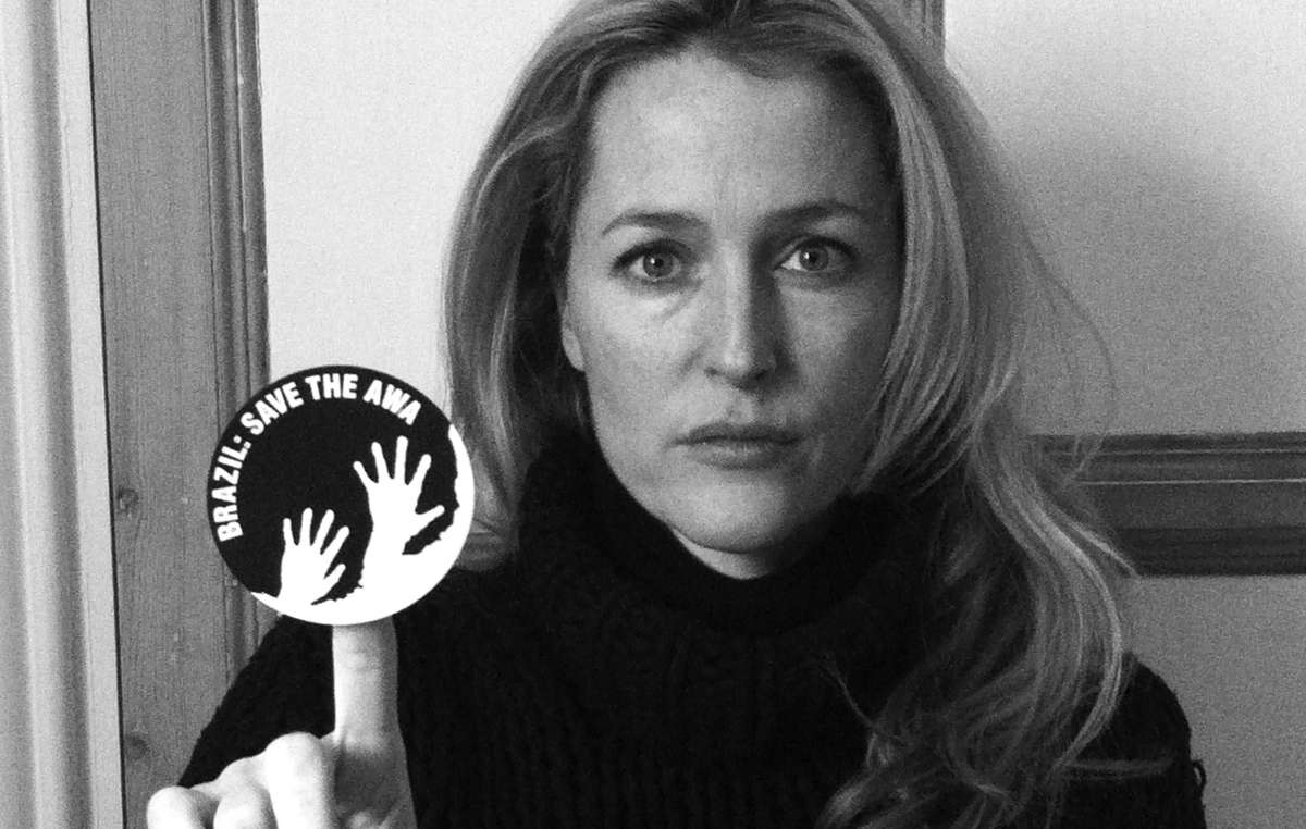 Hollywood star Gillian Anderson brandishes the awáIcon which sends the urgent message, Brazil: Save the Awá.