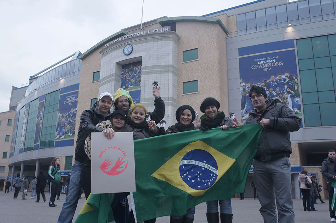 Brazilian fans show their support for the Awá outside the Russia-Brazil football match in London, UK.