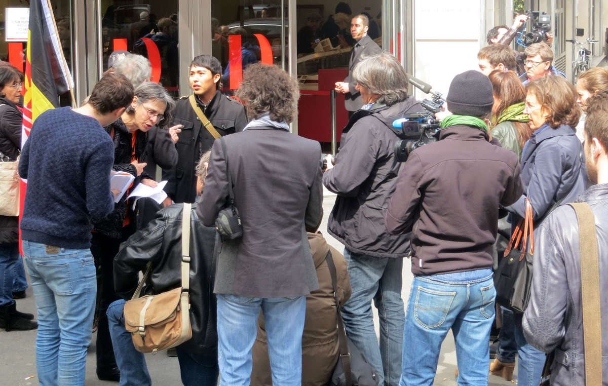 Media outside the auction house in Paris.