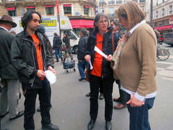 """""""Protesters from Survival International hand out leaflets outside the auction house."""""""