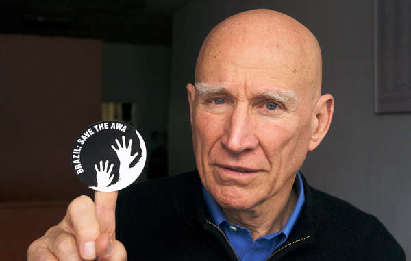 Brazil's Minister of Justice is receiving daily 'Awáicon' photos, such as this one showing internationally renowned photographer Sebastião Salgado supporting the campaign for the Awá.
