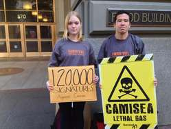 """Protesters in San Francisco were carrying placards to symbolize the lethal effects of the Camisea project on Peru's uncontacted tribes."""