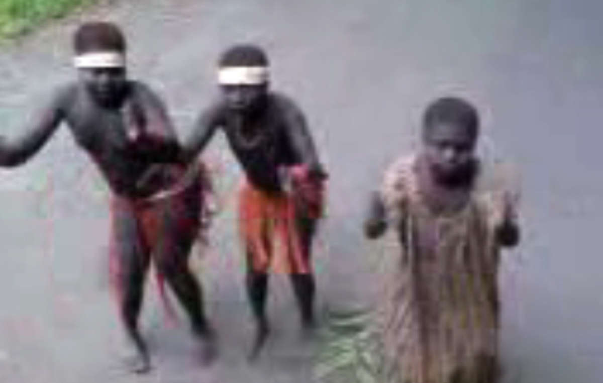 Still from video showing Jarawa girls forced to dance during a human safari.