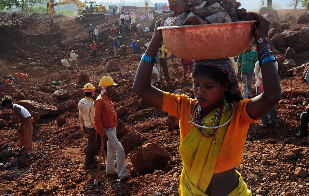 The fate that could await many Baiga threatened with illegal eviction: a Baiga woman works for a pittance in a bauxite mine.
