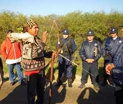 Ayoreo leader Porai Picanerai talks to police