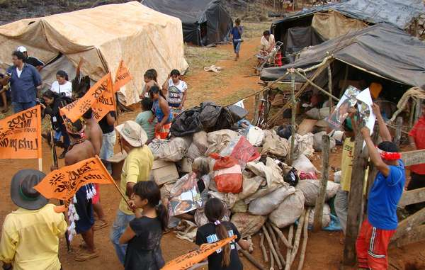 The Guarani of Laranjeira Ñanderu are forced to camp by the side of a road after being evicted from their land.