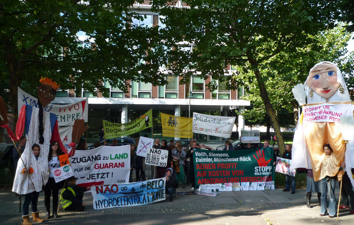 Supporters of Survival, FIAN and other NGOs held a protest in Berlin against Brazils assault on indigenous rights.