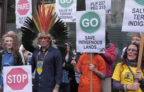 Nixiwaka fronted a Survival protest against Brazil's onslaught against indigenous peoples' constitutional rights.