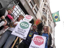"""""""Protestors wielded placards to show their support for indigenous peoples' protests sweeping Brazil."""""""