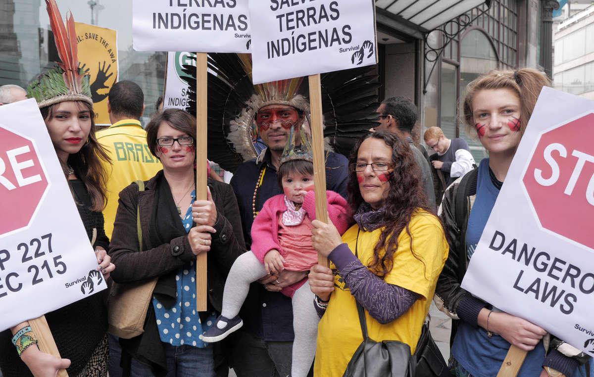 Protestors held placards telling Brazil to stop dangerous laws and save indigenous lands.