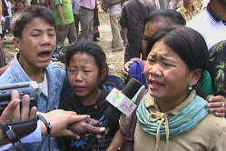 The children of Ms Buddhapati Chakma, who was shot dead by soldiers, speak to local journalists. 2010.