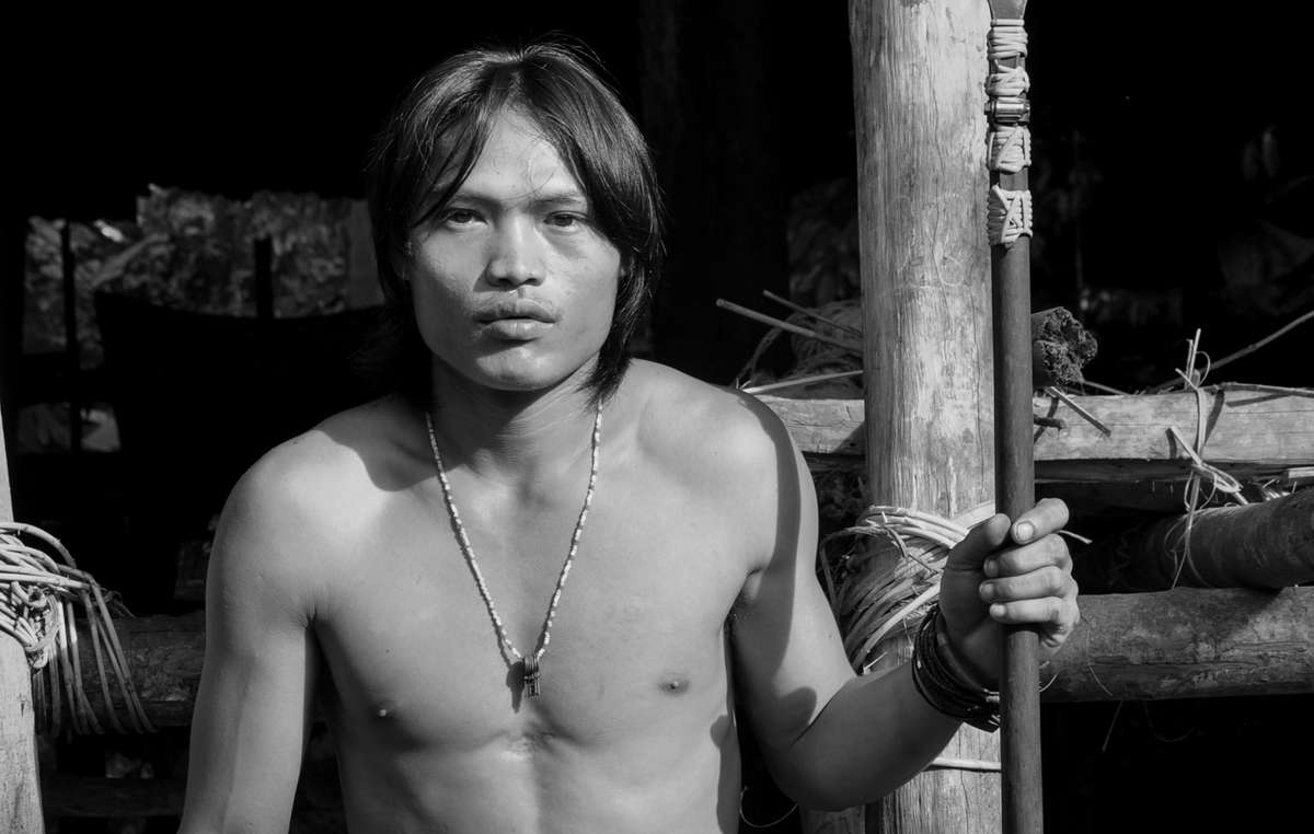 Puiyun, a Penan man, holding a blowpipe (keleput)