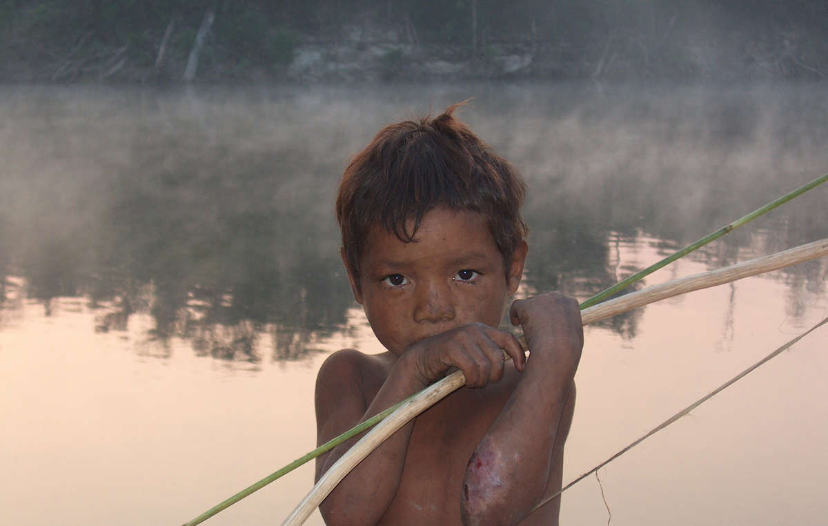 The small Pirahã tribe will be affected by the Madeira river dams in the Western Amazon, Brazil. These mega dams threaten to harm or destroy large areas of land which are home to numerous tribal peoples.