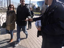 """""""In Madrid protestors handed out leaflets at the Fitur travel fair."""""""