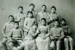Apache children after being taken from their families and sent to a white-run school. USA, 19th Century.