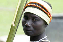 Jarawa woman returning to her forest after gathering food on the edges of the Jarawa reserve.