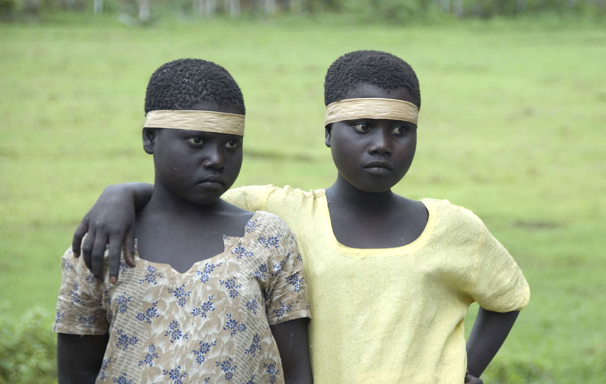 Two Jarawa girls in clothes given to them by outsiders. Encroachment onto their land risks exposing the Jarawa to diseases to which they have no immunity.
