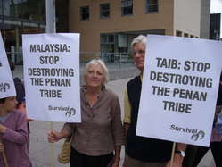 Chief Minister Taib Mahmud was met by demonstrators protesting at the destruction of the Penan's rainforest.