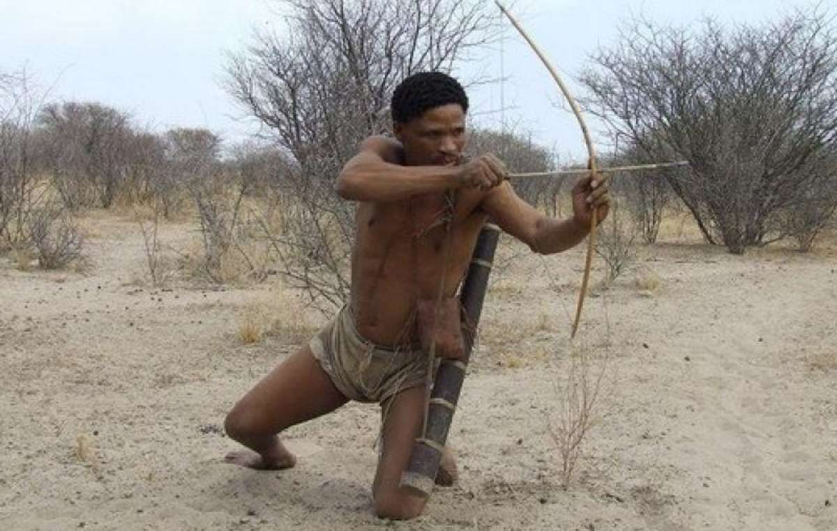 The Botswana Tourism Organization uses images like this one of the Bushmen hunting, while in reality they are banned from hunting and arrested if they do.