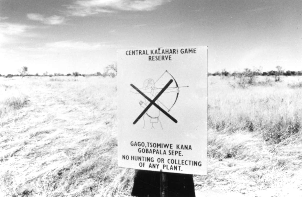 Notice banning Bushmen from hunting at the entrance to the Central Kalahari Game Reserve, Botswana 1989.
