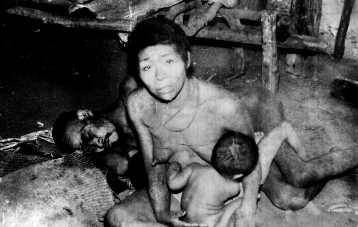 Aché Indians shortly after they were captured and brought out of the forest to the Aché 'Reservation'. Six months later these three had died. Paraguay 1971.