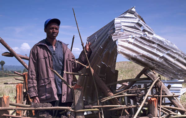 An Ogiek man stands inside the remains of his house after an eviction in Ngongeri, Njoro, Kenya.