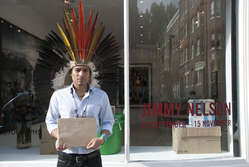 """Nixiwaka Yawanawá protested against the """"outrageous"""" exhibition of Jimmy Nelson's work at London's Atlas Gallery, wearing his ceremonial headdress."""