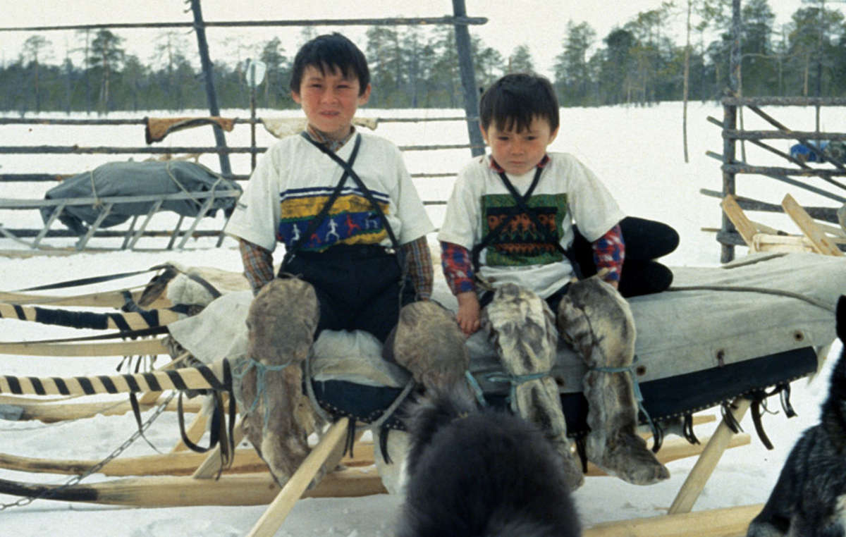 Khanty children of Siberia on a sleigh.