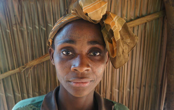 This Baka woman and her husband are among many tribal people in Cameroon who have been beaten by WWF-funded wildlife guards. They were attacked and had their belongings taken from them while they were collecting wild mangoes.
